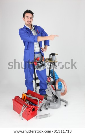 Labourer stood, by equipment pointing