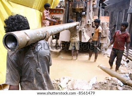 stock photo : labourers at construction site, delhi, india