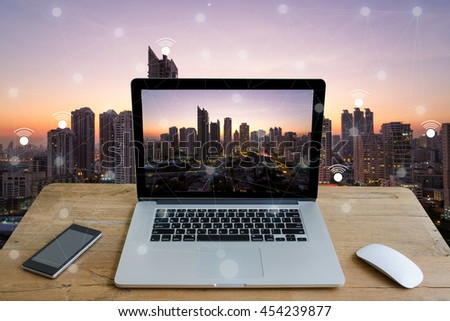 labtop and city scape and network concept