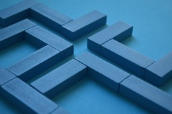 Labyrinth concept. Abstract pattern made blue wooden bricks. Stalemate or deadlock. Labyrinth game. Find exit. Modern art. Labyrinth and making decisions.