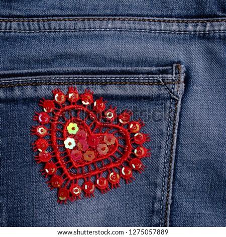 Lace decorative heart on blue denim background. Selective focus. #1275057889