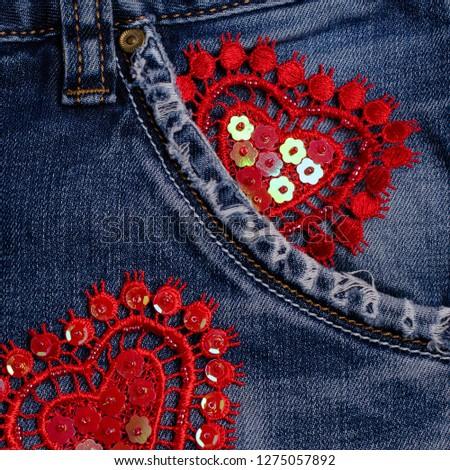 Lace decorative heart on blue denim background. Selective focus. #1275057892