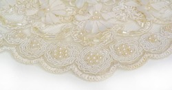 Lace in soft beige. Texture. background. template. abstract background with pale beige rod, old lace and cream lines. can be used for postcard, poster, texture or wallpaper