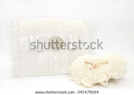 Lace wedding accessories. Wedding rings on a white satin pillow. Wedding gift box. Wedding decoration.