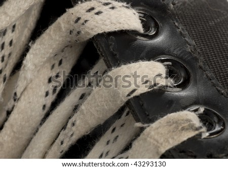 laces details on pair of worn hockey skate