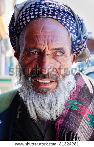 LADAKH, INDIA - JULY 15: Unidentified senior man in Ladakh, July 17, 2009. Census reveals that in the region, Muslims constitute 47.4%, Buddhists 45.9%, Hindus 6.25%, Sikhs 0.31% and Christians 0.17%. - stock photo