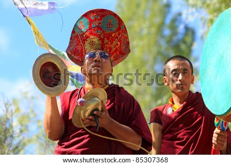 LADAKH, INDIA - SEPTEMBER 6: Buddhist monks play music on instruments during the praying ceremony on September 6, 2011 in Leh's monastery, Ladakh, India.