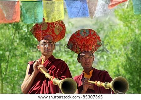 LADAKH, INDIA - SEPTEMBER 6: Buddhist monks play music on trumpets during the praying ceremony on September 6, 2011 in Leh's monastery, Ladakh, India. - stock photo