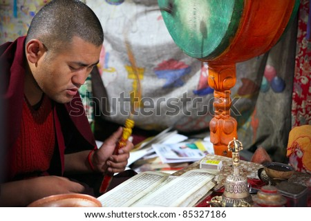 LADAKH - SEPTEMBER 4: Buddhist monk prays on the morning ceremony on September 4, 2011 in  Thiksey Gompa, Ladakh, India.