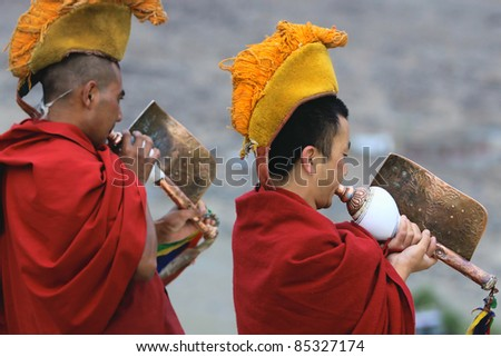 LADAKH - SEPTEMBER 4: Buddhist monks play ritual music on tibetan conchs during the morning ceremony on September 4, 2011 in  Thiksey Gompa, Ladakh, India.