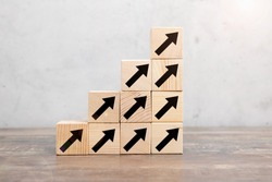 Ladder career path for business growth success process concept. Hand arranging wood block stacking as step stair with arrow up