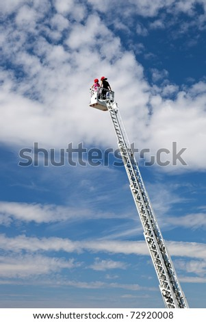 Ladder extended on a fire truck.