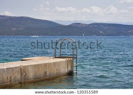 Ladder for swimming on Adriatic sea in Croatia