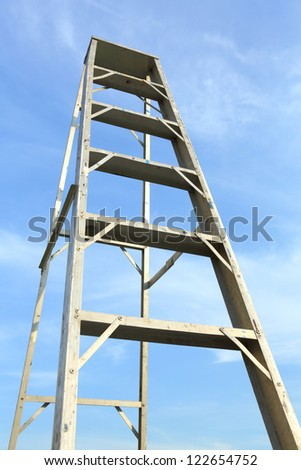 Ladder in blue sky mean the way to top