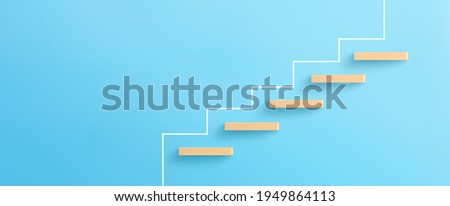 Ladder of success in business growth concept, Wooden block stacking as step stair on blue background, copy space Stock foto ©