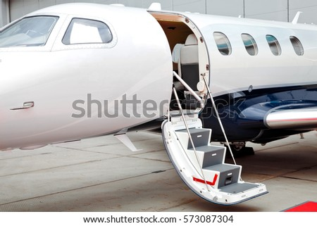 Ladder with open door in business jet airplane