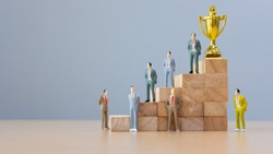 Ladders to the goal of success in business. Competition. Strategy.