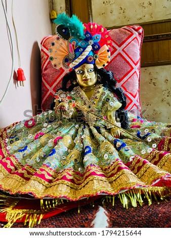 Laddu Gopal Ji with Dress, Mukut and Flute Stock photo ©