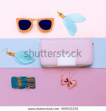 Ladies Fashion Accessories. Pink Clutch, Sunglasses and Jewelry. Pastel Colors Trend
