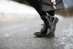 Ladies fashion leather shoes for autumn, spring, European winter. Boots for a modern grunge women. Women's black boots with laces . Autumn. Spring. Fashion. Style. Top view. Punk style