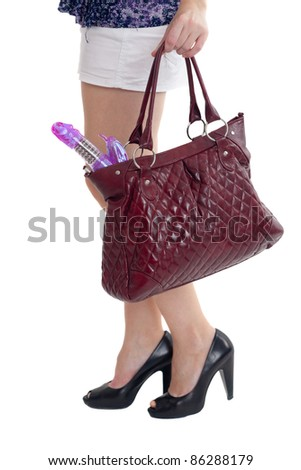 Ladies handbag in hands with the vibrator