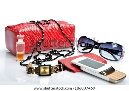 Ladies handbag with cosmetics, accessories, sunglasses, cell phone, watch