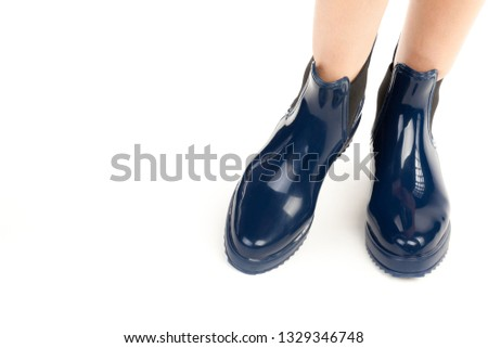 718ebacd3e Long slim female's legs wearing rubber boots. Fashion mockup with copy