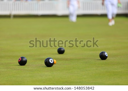 Ladies playing lawn bowls