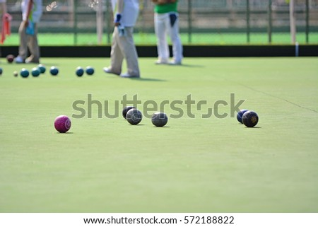 Ladies playing lawn bowls. Soft focus on the blurred background. #572188822