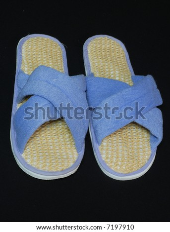 ladies slippers with an exfoliating sole for beauty treatment