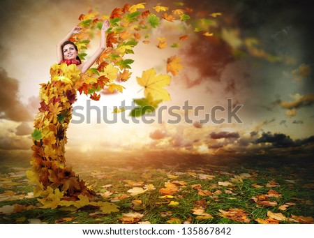 Lady Autumn with wings from falling leaves