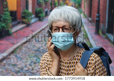 Lady calling outdoors during pandemic