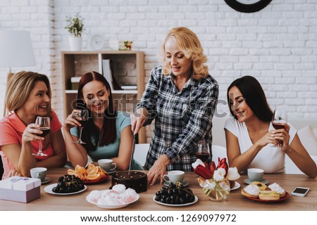 Lady Cut Cake for Friends. Happiness Time for all Family. Smile and Young Girl Celebrate Together. Cake for Girl. Happy Family Day. Cut Cake for Family. Love Day for all Women. Diner with Family.