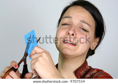 lady cutting up credit card in despair