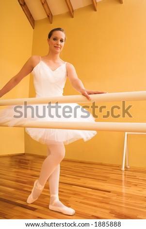 Lady doing ballet in a dance studio