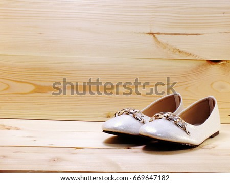 lady flat shoes on wooden...