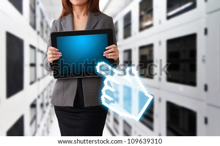 Lady hold digital touch pad in data center room and digital hand point to her