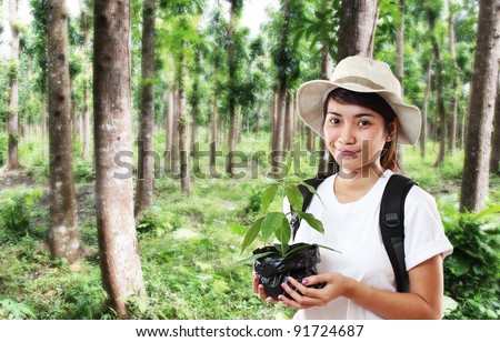 Lady holding a young tree for planting