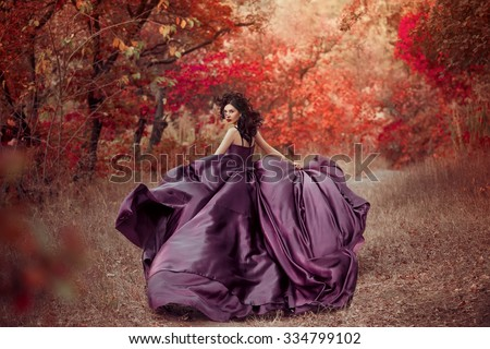 Lady in a luxury lush purple dress ,fantastic shot,fairytale princess is walking in the autumn forest,fashionable toning,creative computer colors
