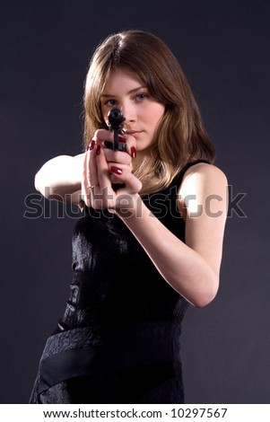 lady in black handing pistol