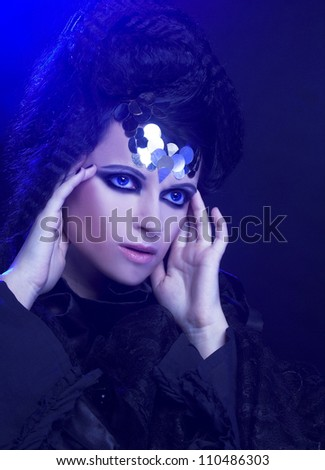 Lady in black. Young stylish woman with artistic visage.