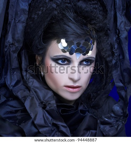 Lady in black. Young stylish woman with artistic visage near curtain.