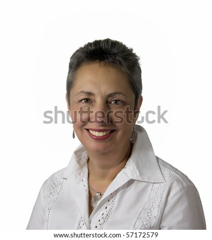 Lady in middle age smiling broadly at the camera and isolated against white