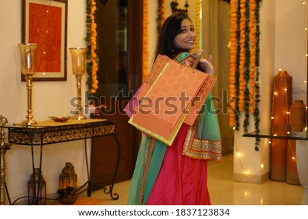 Lady in tradional dress with shopping bags