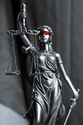 Lady Justice black and white with red blindfold. Symbol of law or lawyer.