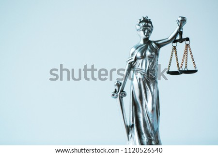 Lady Justice statue in law office. Figurine with blindfold, balance and sword is personification of moral force in judicial system and it's origin is Lustitia, goddess of Justice in Roman mythology