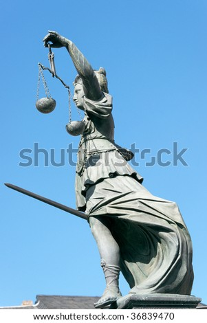 Lady Justice stature in Frankfurt. - stock photo