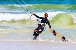 Lady Kite boarder entering the surf