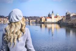 Lady looking at Charles Bridge, in Prague. Czeh Republic