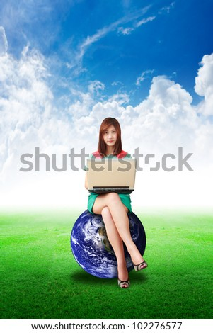 Lady on globe hold notebook computer and look a me : Elements of this image furnished by NASA